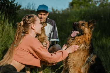 active-family-fitness-couple-pet-love-dog-training-best-dog-breeds-for-family-young-sports.jpg